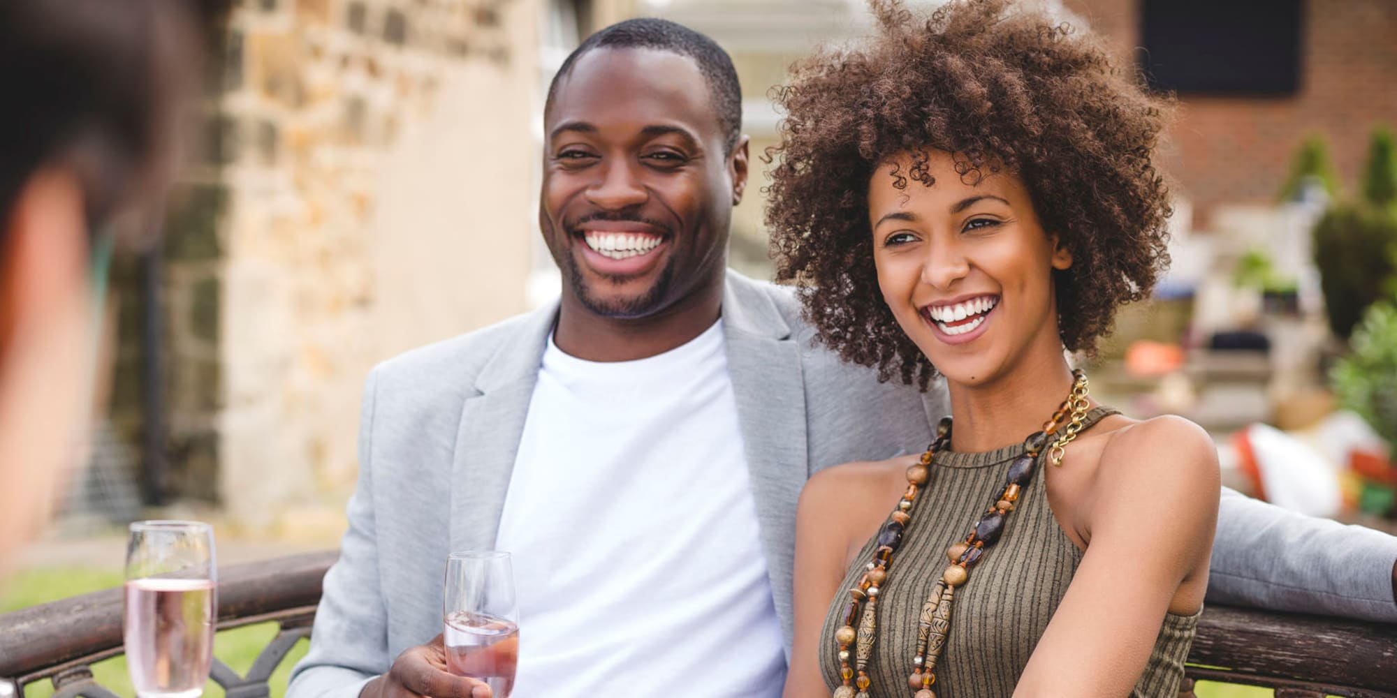 Resident couple enjoying champagne and meeting new people at an outdoor event near L'Estancia in Studio City, California