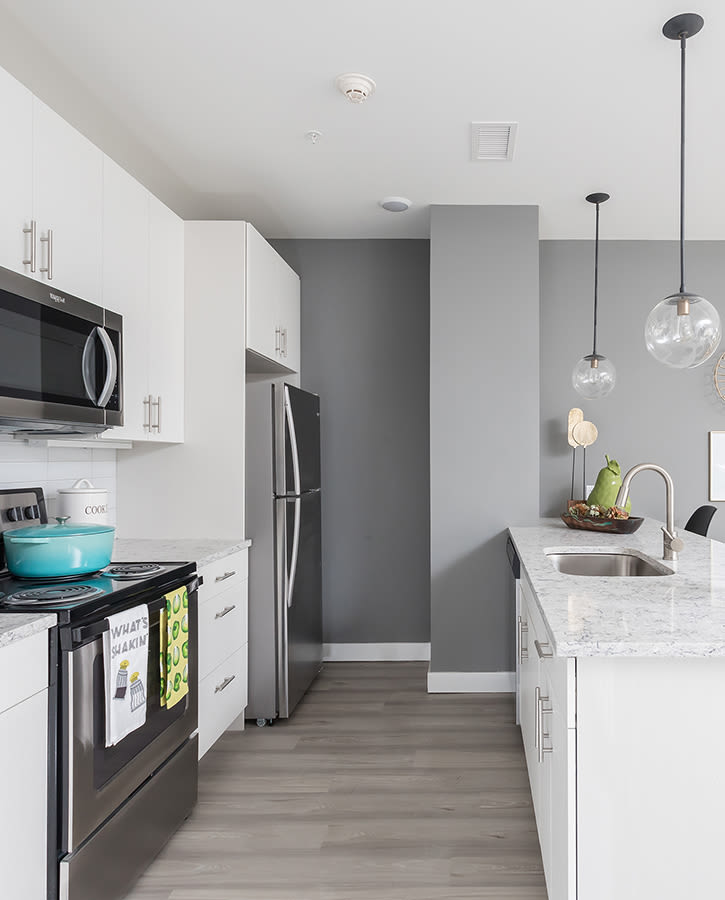 Gourmet kitchen in a model home at 50 Front Luxury Apartments in Binghamton, New York