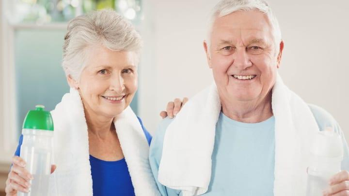 Two seniors holding water bottles