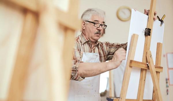 Elderly man painting at Anthology of Wheaton in Wheaton, Illinois