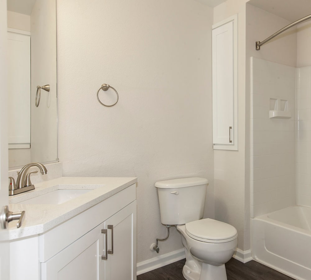 Luxury bathroom with white counter tops at Park Central in Concord, California