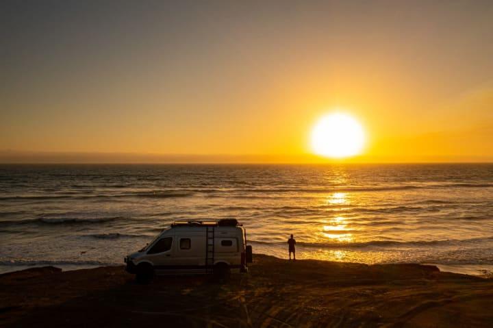 Sean C. watching a sunset