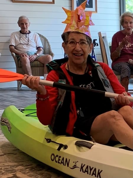 A Carolina Park resident competes in the kayak bean bag toss event!