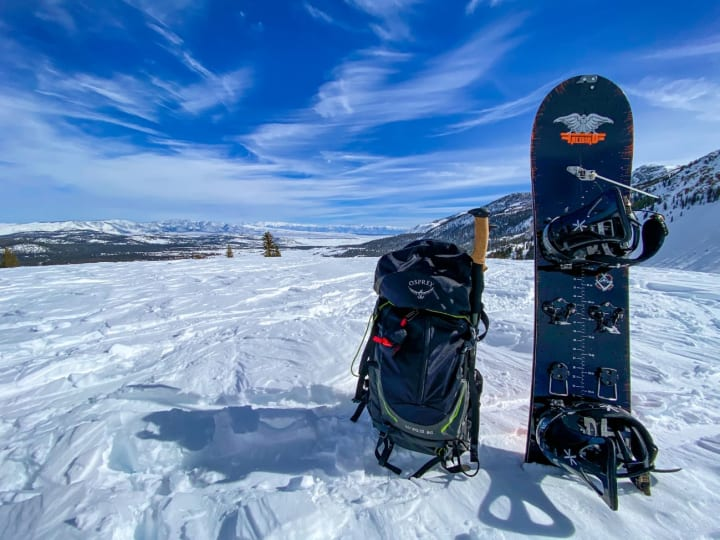 Snowboard standing in the snow