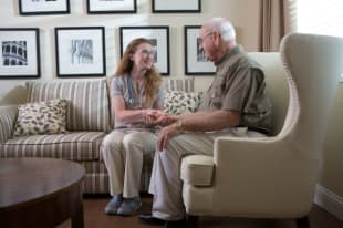 Resident talking to nurse at Discovery Village At Southlake in Southlake, Texas