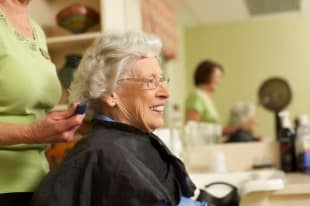 Resident getting hair cut at Discovery Village At Boynton Beach in Boynton Beach, FL