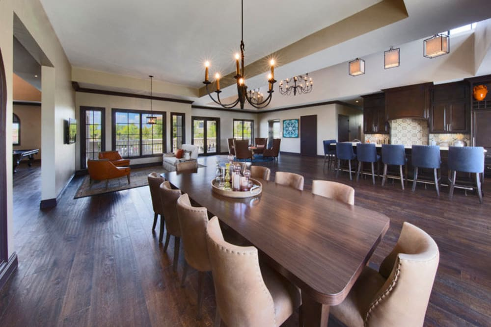 Meeting table and more in the well-decorated clubhouse at Town Fontainebleau Lakes Apartment Residences in Miami, Florida