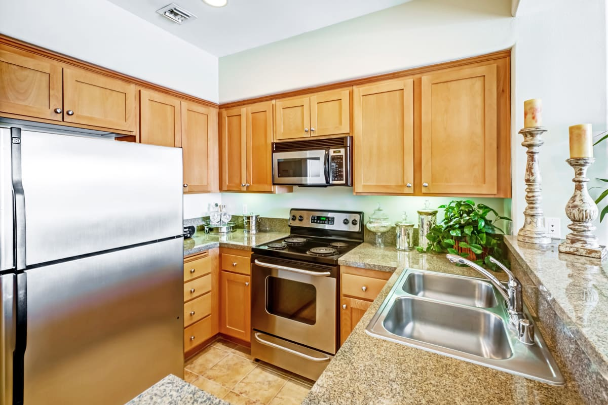 Modern kitchen with stainless-steel appliances in a model apartment at The Villa at Marina Harbor in Marina del Rey, California