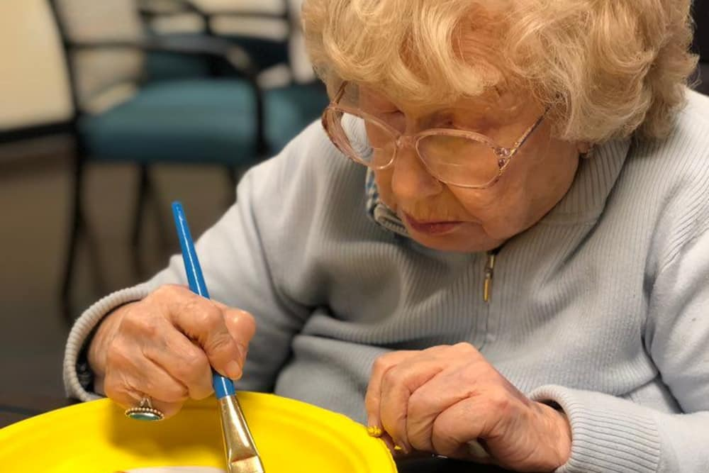 A resident painting at Aspen Place Health Campus in Greensburg, Indiana