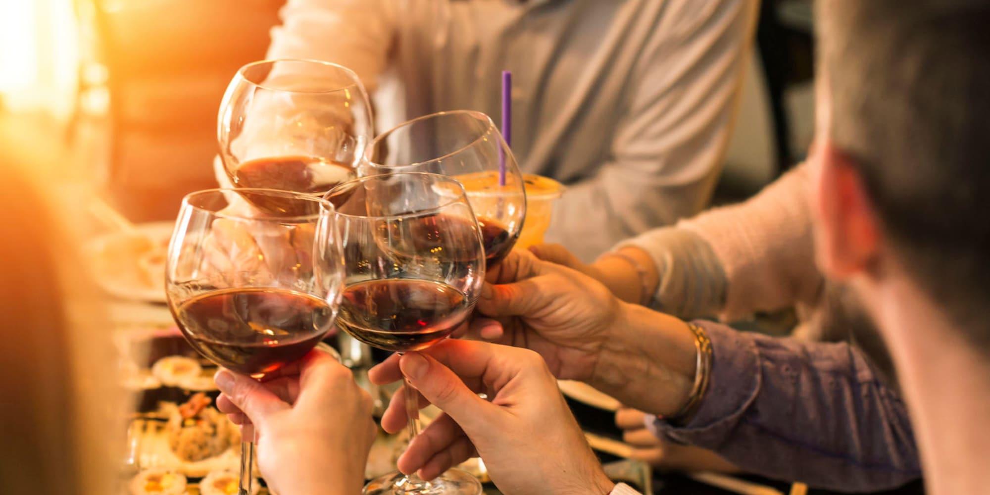 Resident friends enjoying wine and lively conversation at their favorite restaurant near Pleasanton Glen Apartment Homes in Pleasanton, California