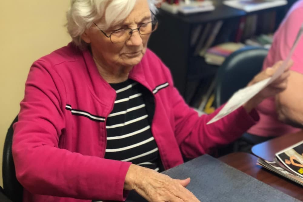 A resident making a collage at Aspen Place Health Campus in Greensburg, Indiana