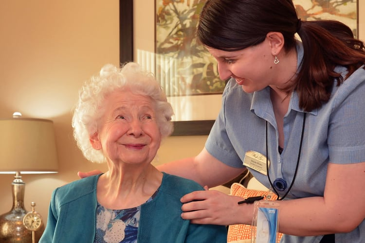 Happy resident and caregiver at lBPM Senior Living