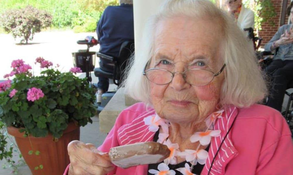 smiling senior resident enjoying some ice cream