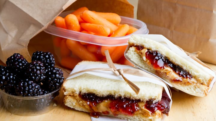 Delicious peanut butter and jelly sandwich with a side of carrots and blackberries at The Hawthorne