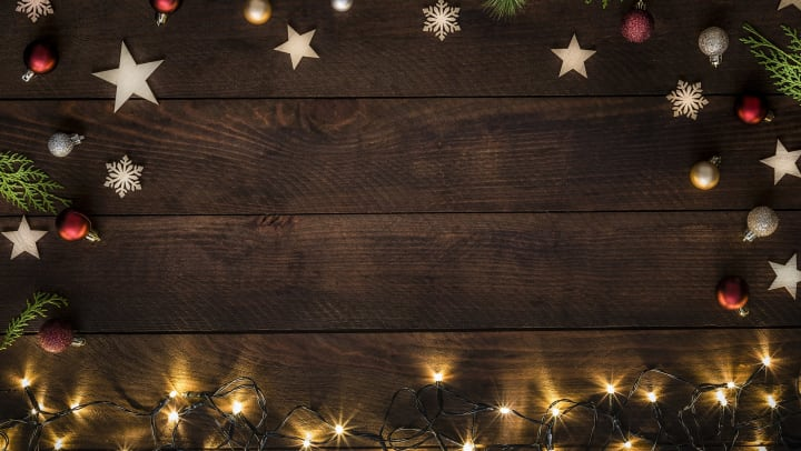 Christmas decorations around a wooden plank