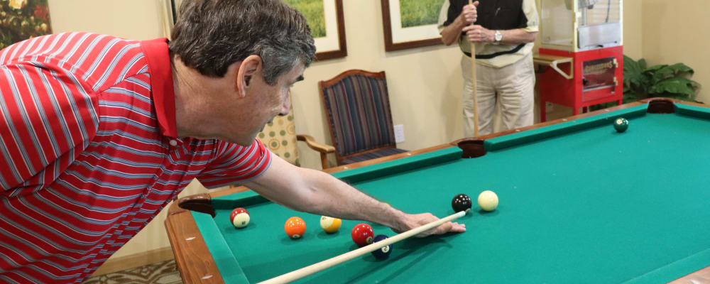 Residents shooting pool at The Springs at Sunnyview in Salem, Oregon
