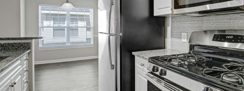 Kitchen with stainless steel appliances at Bradlee Danvers in Danvers, Massachusetts