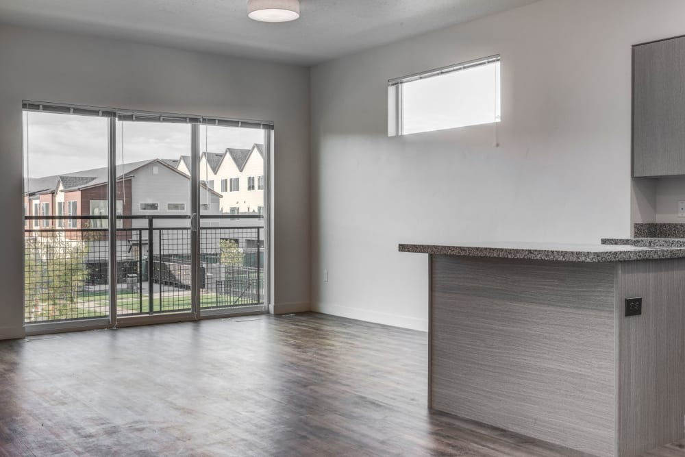 Open-living room with a large sliding glass down out to the balcony at Hawthorne Townhomes in South Salt Lake, Utah