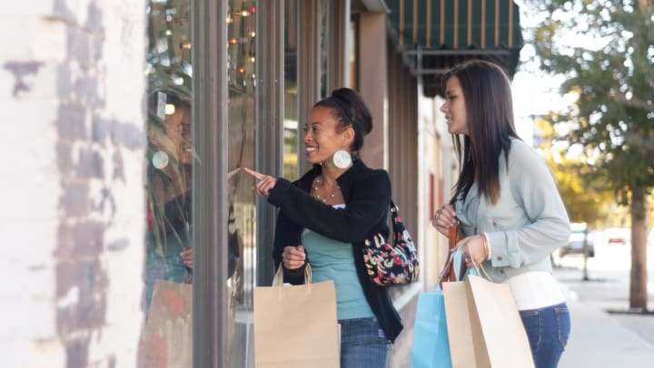Two woman shopping in Fort Worth, Texas near Olympus 7th Street Station