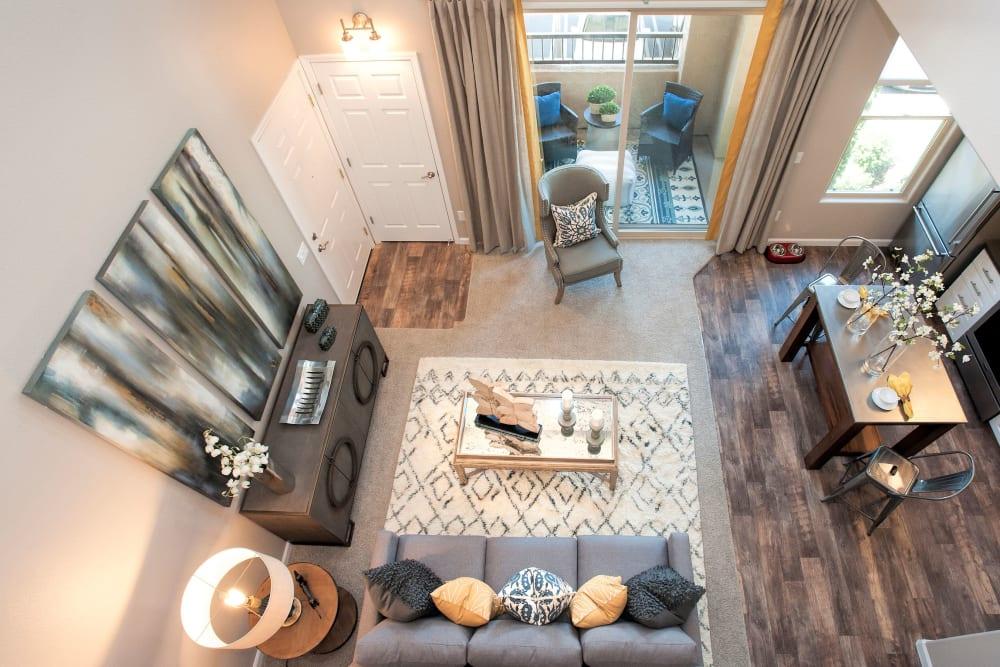 Large living room with a balcony at Venu at Galleria Condominium Rentals in Roseville, California
