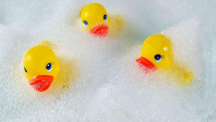 3 yellow rubber duckies in bubbles