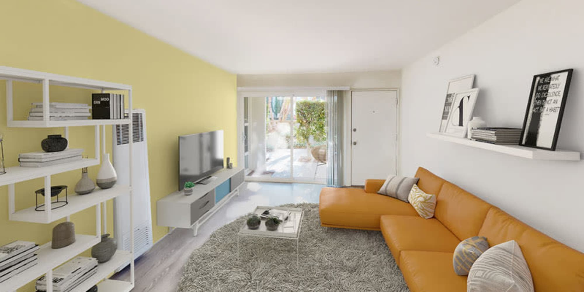 Colorful living room of a one bedroom apartment at West Park Village in Los Angeles, California