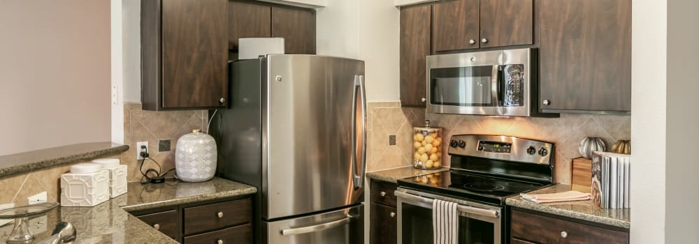 Spacious kitchen with stainless-steel appliances at The Fuse at Park Row in Houston, Texas