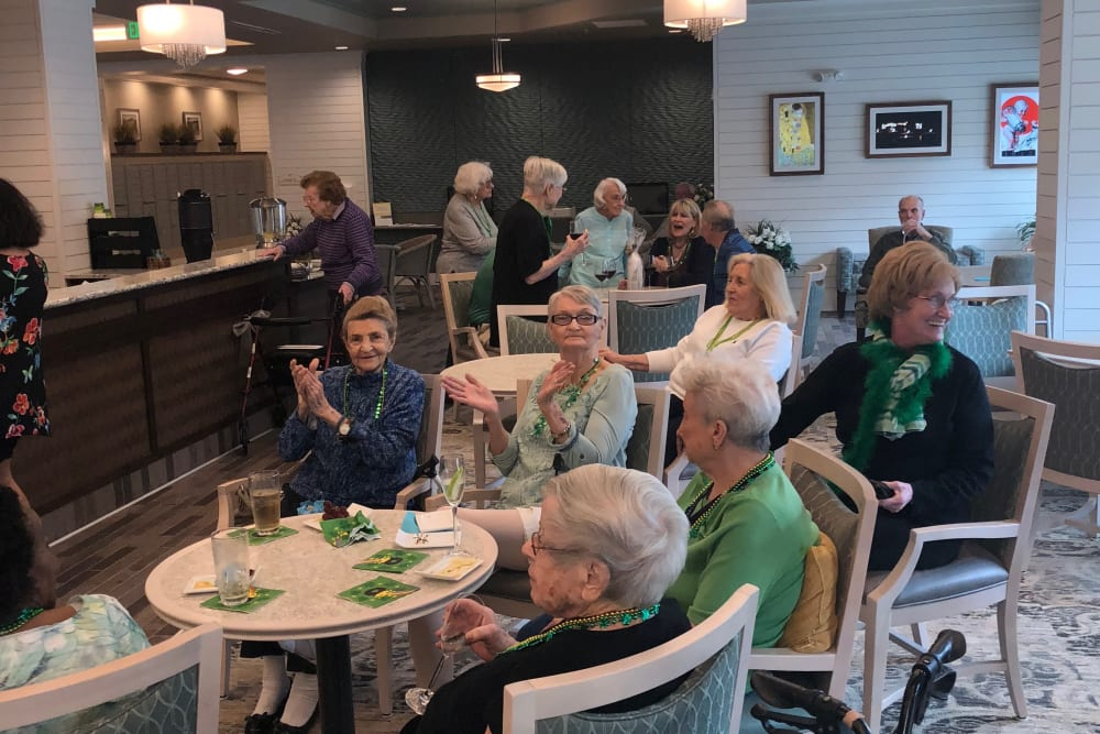 Residents enjoying St. Patty's Day together at Merrill Gardens at Carolina Park in Mount Pleasant, South Carolina.