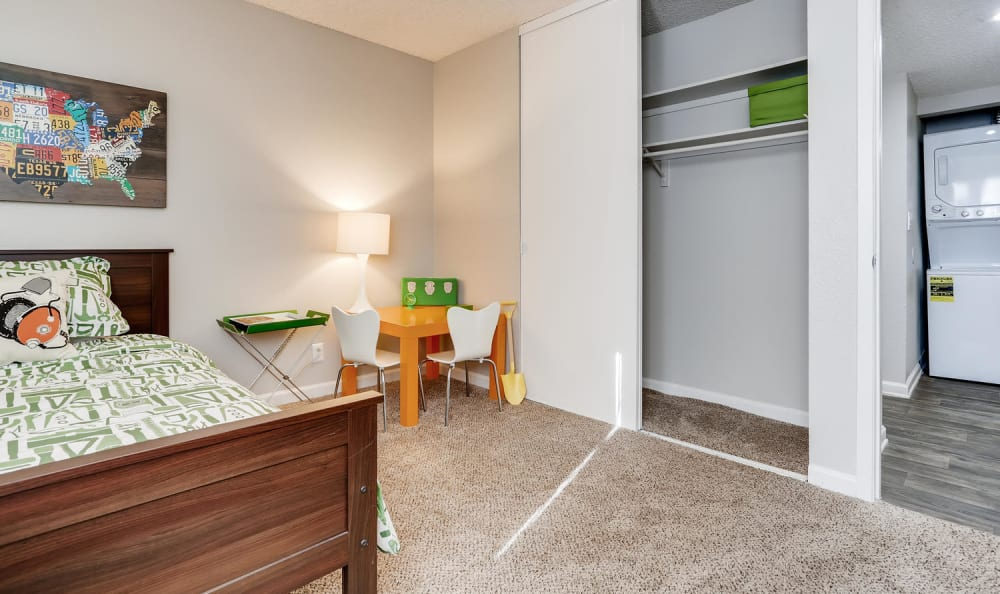 Open bedroom with spacious sliding door closet at The Ranch at Bear Creek Apartments & Townhomes in Lakewood, Colorado