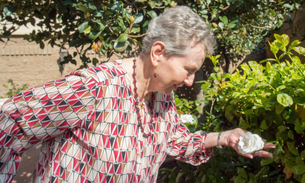 Senior enjoying outdoor garden at The Fair Oaks in Pasadena, California