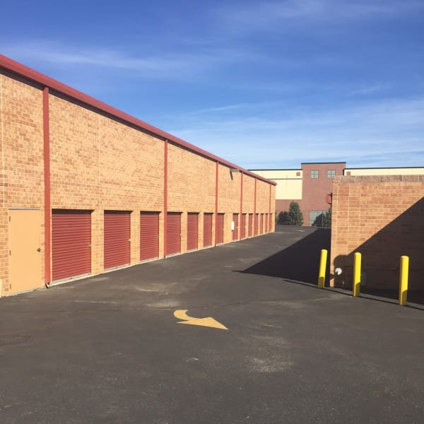 Outdoor storage units with wide driveways at StorQuest Self Storage in Highlands Ranch, Colorado