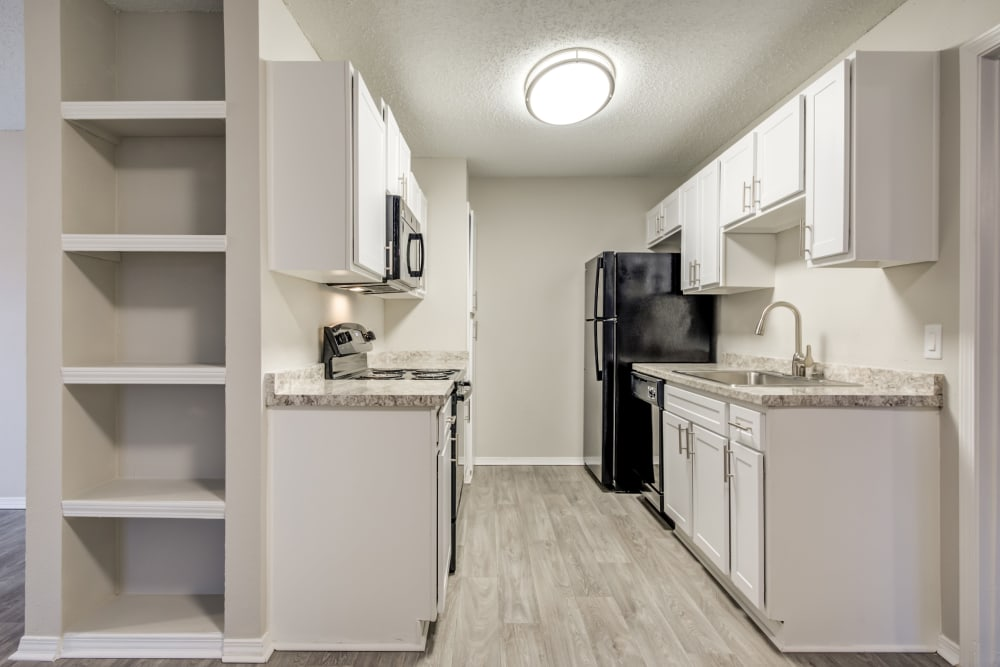 Extra storage next to the modern kitchen in a model home at The Arbors of Carrollton in Carrollton, Texas
