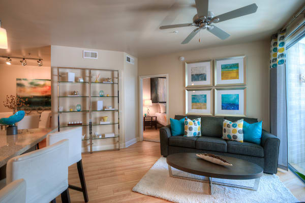 Open-concept living area with hardwood floors and ceiling fan in model home at Level at Sixteenth in Phoenix, Arizona