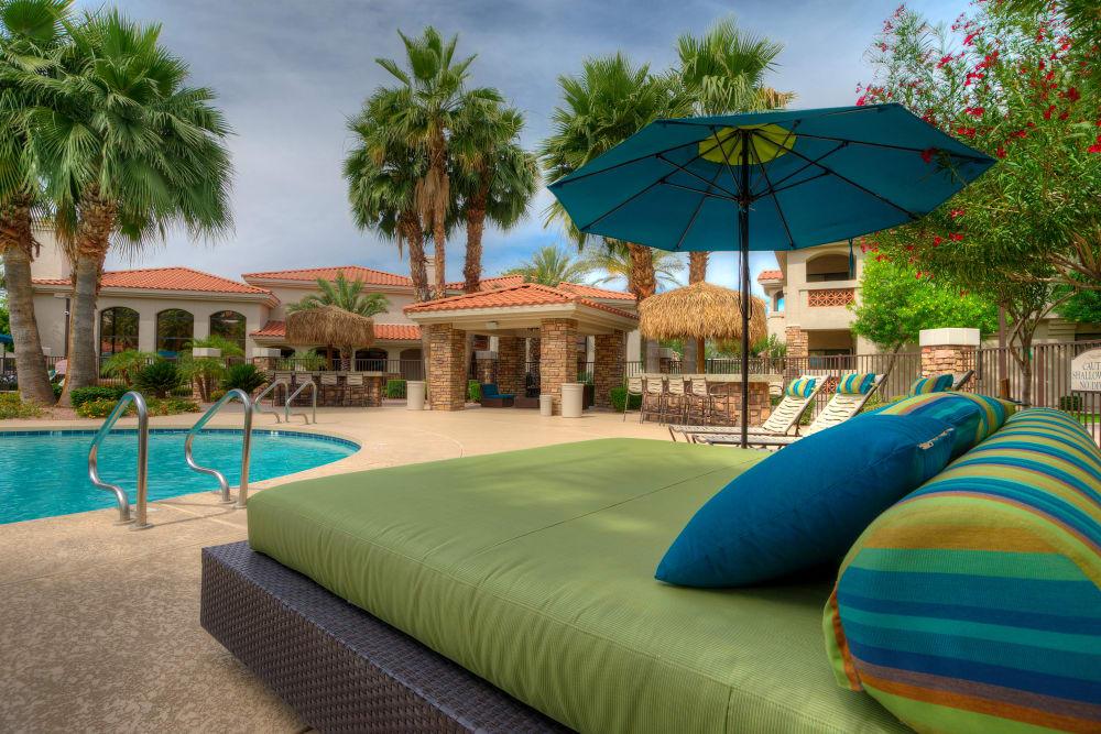Comfortable seating outside around resort style pool at San Marbeya in Tempe, Arizona