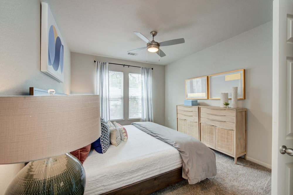 Well decorated bedroom with plenty of natural light  at Ingleside Apartments in North Charleston, South Carolina