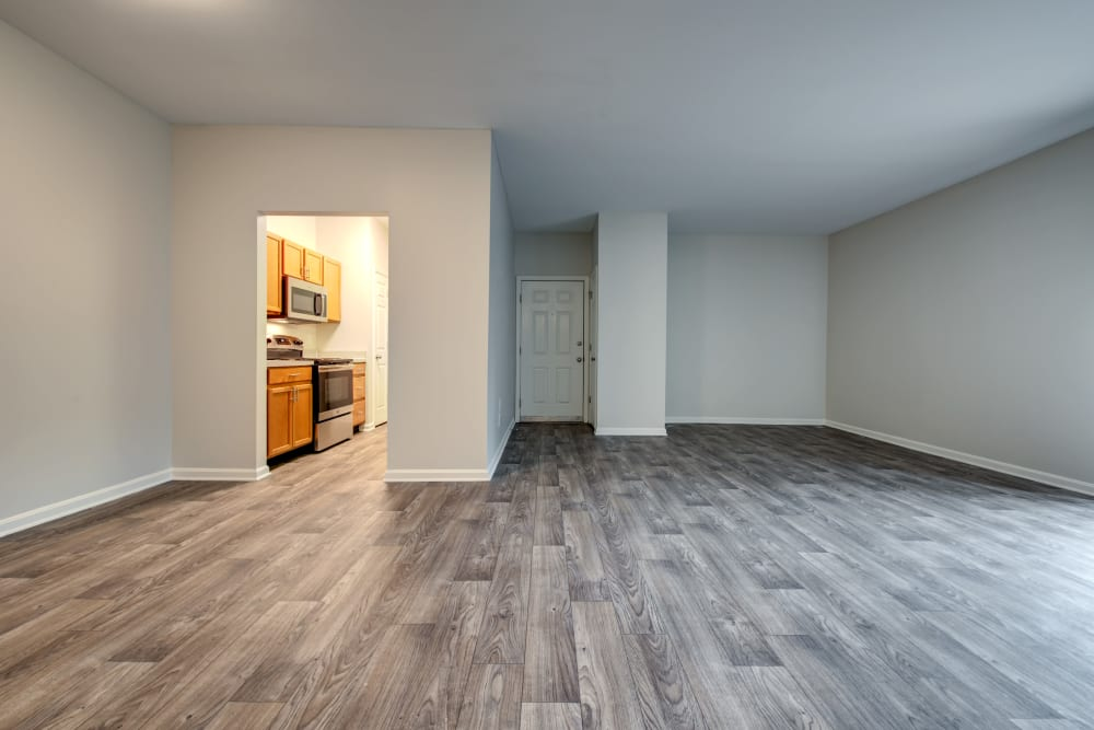 Large living room with kitchen at Cooper Creek in Louisville, Kentucky