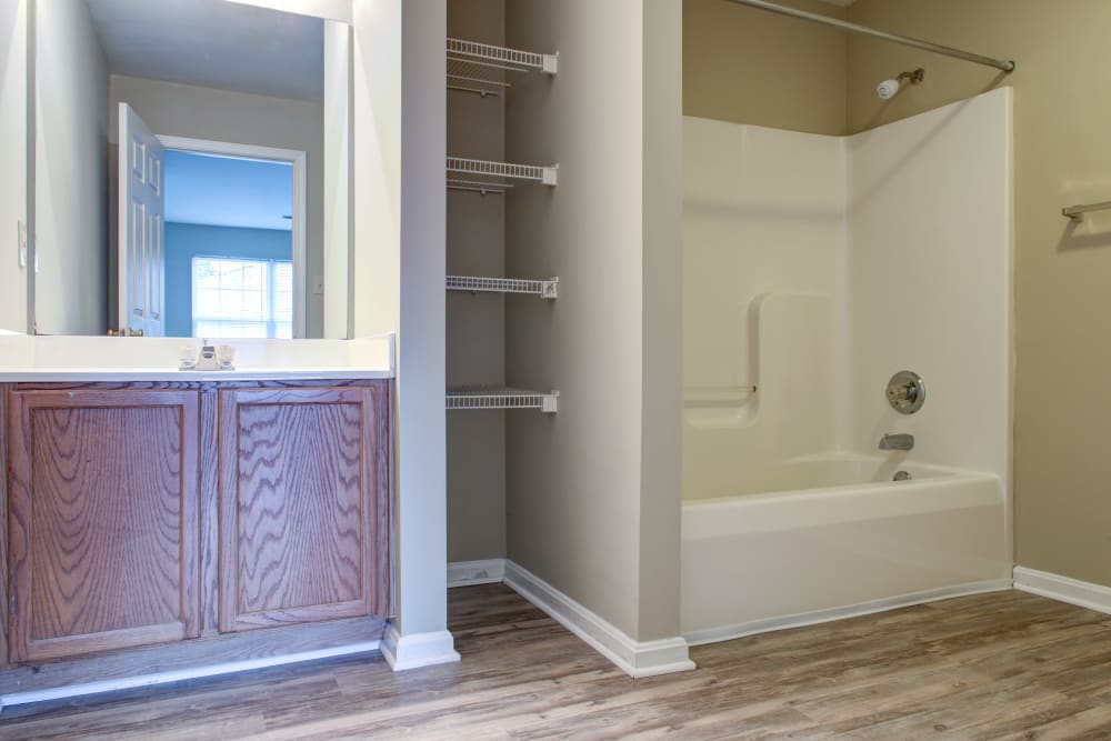 Large master bathroom with shelving at Cooper Creek in Louisville, Kentucky
