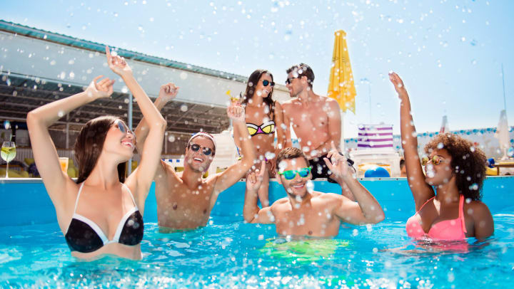 Friends enjoying the beautiful pool at Olympus Encantadain Albuquerque, New Mexico