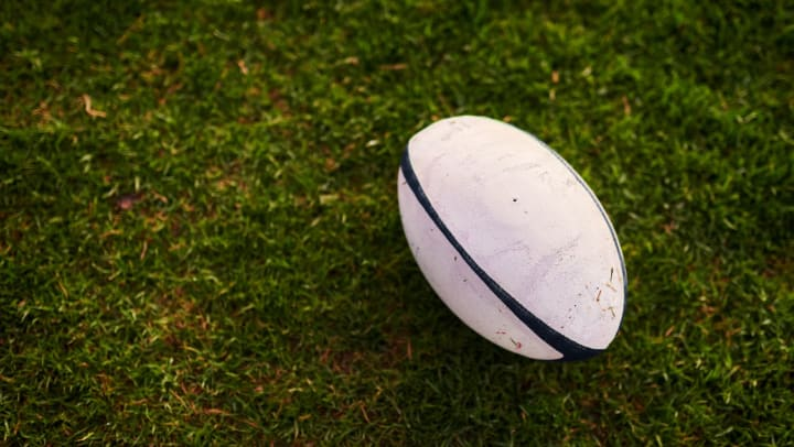 Close-up of a rugby ball on a grass field