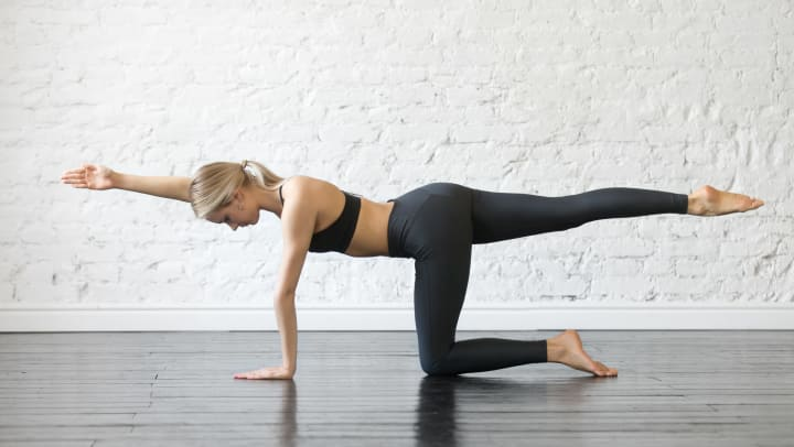 Woman performing ab exercise on the ground