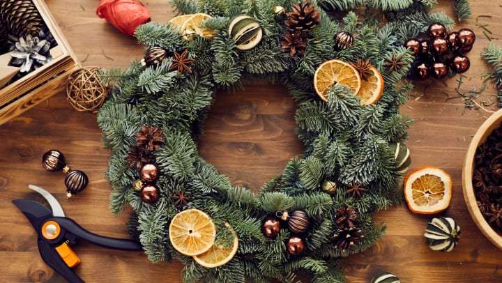 Wreath creation with dried fruits on a craft table