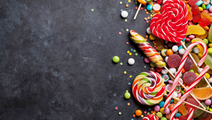 Colorful candies on stone background