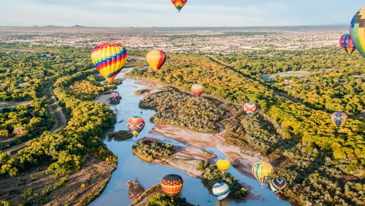 Hot air balloons above  Albuquerque near Olympus Encantada