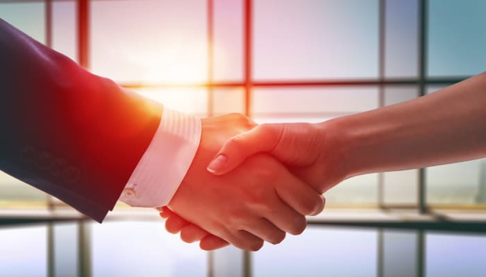 Two people shaking hands at Avenida Partners, LLC in Newport Beach