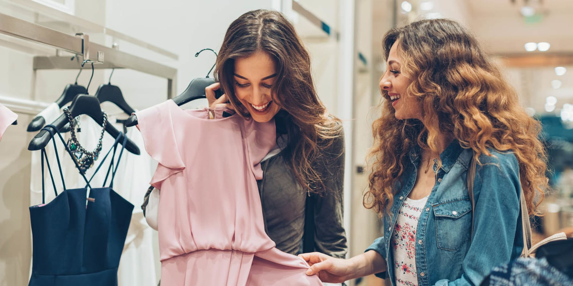 Resident friends shopping at one of the local clothing stores near Seville Uptown in Dallas, Texas
