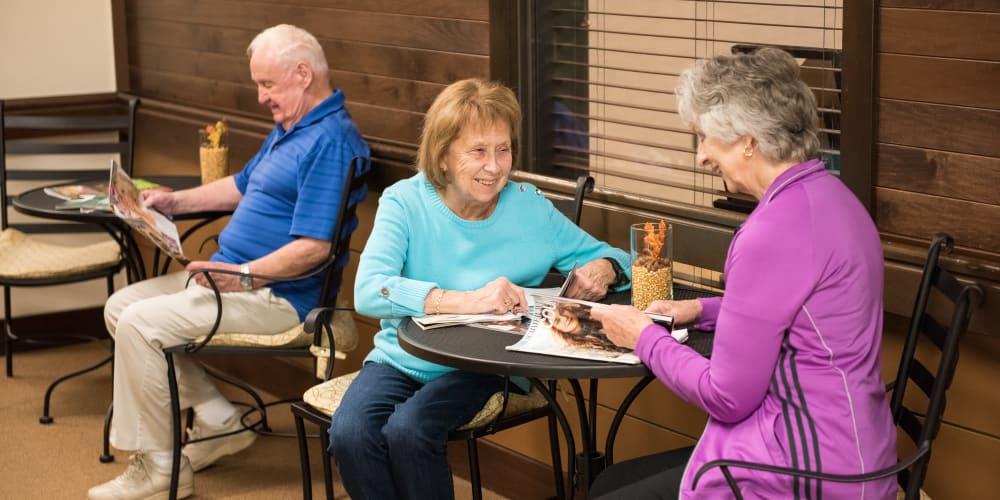 Senior living residents reading magazines at The Springs at Tanasbourne in Hillsboro, Oregon