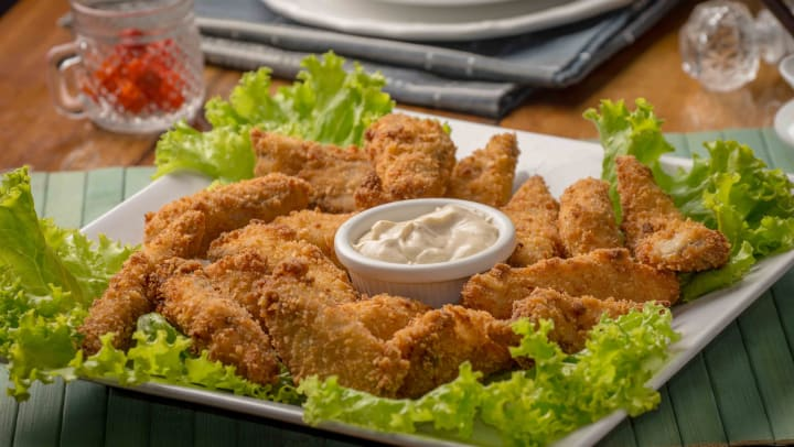 Delicious meal of fried chicken served on a bed of lettuce at a restaurant near The Hawthorne in Jacksonville, Florida