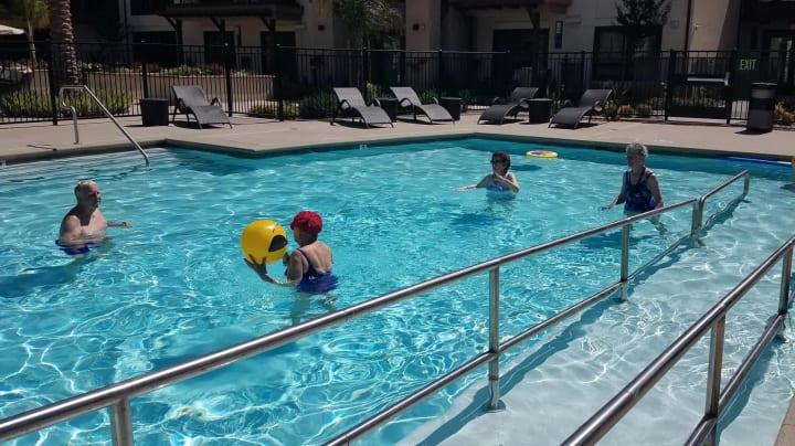 Residents enjoying the pool at Merrill Gardens at Rancho Cucamonga