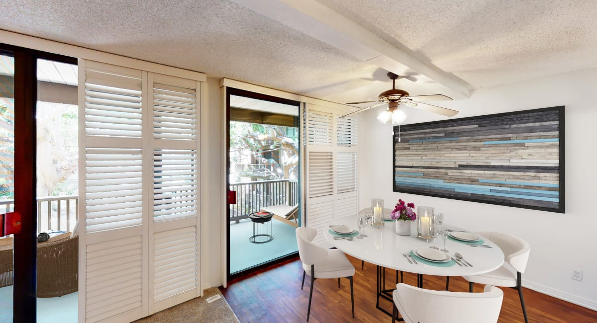 Dining room with large sliding doors and balcony in a luxury apartment home at Mariners Village in Marina del Rey, California