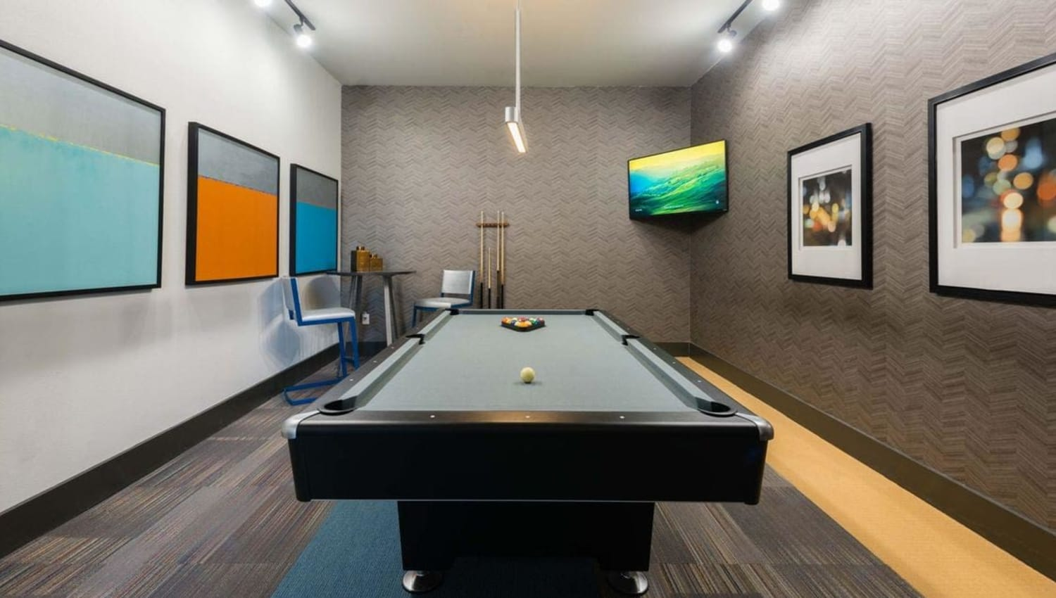 Clubhouse with billiards table and TV at Olympus at Waterside Estates in Richmond, Texas
